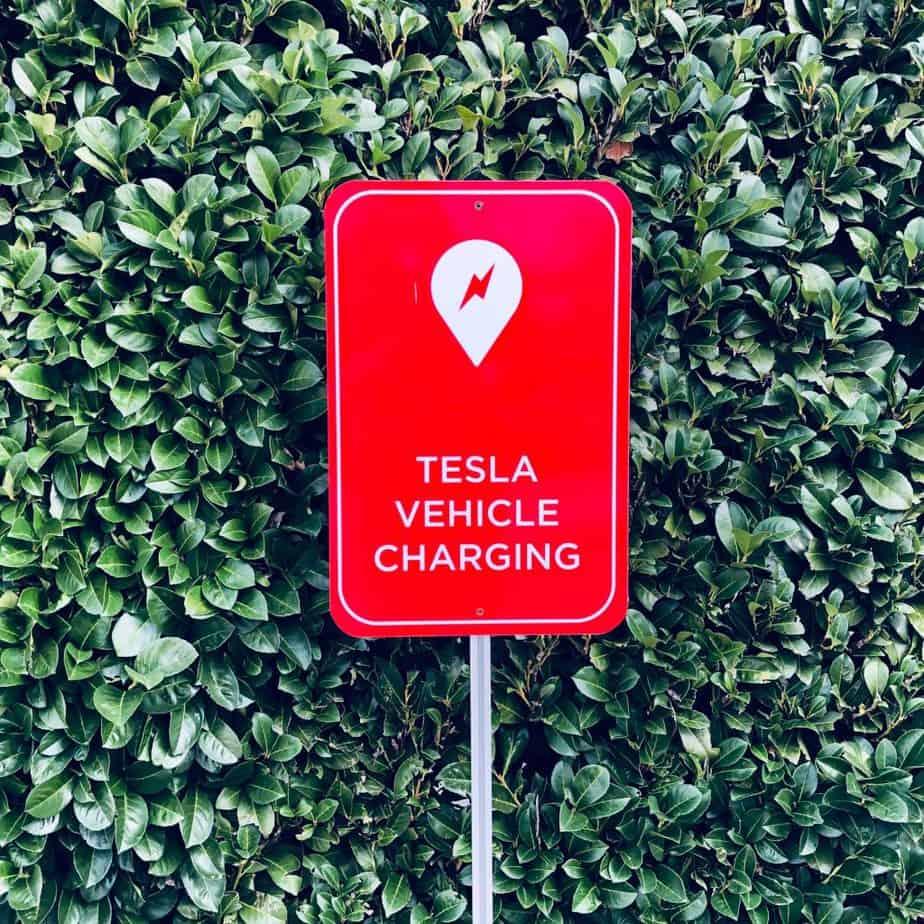 Tesla electric car free parking sign